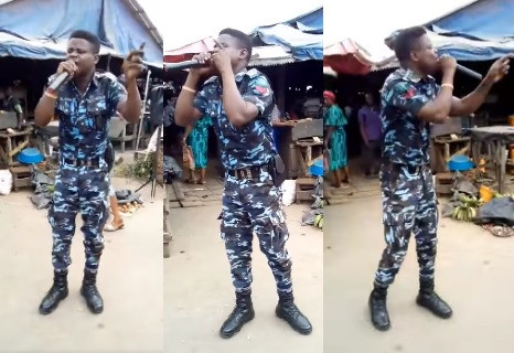 Police officer spotted in his uniform preaching the gospel at a market in anambra state