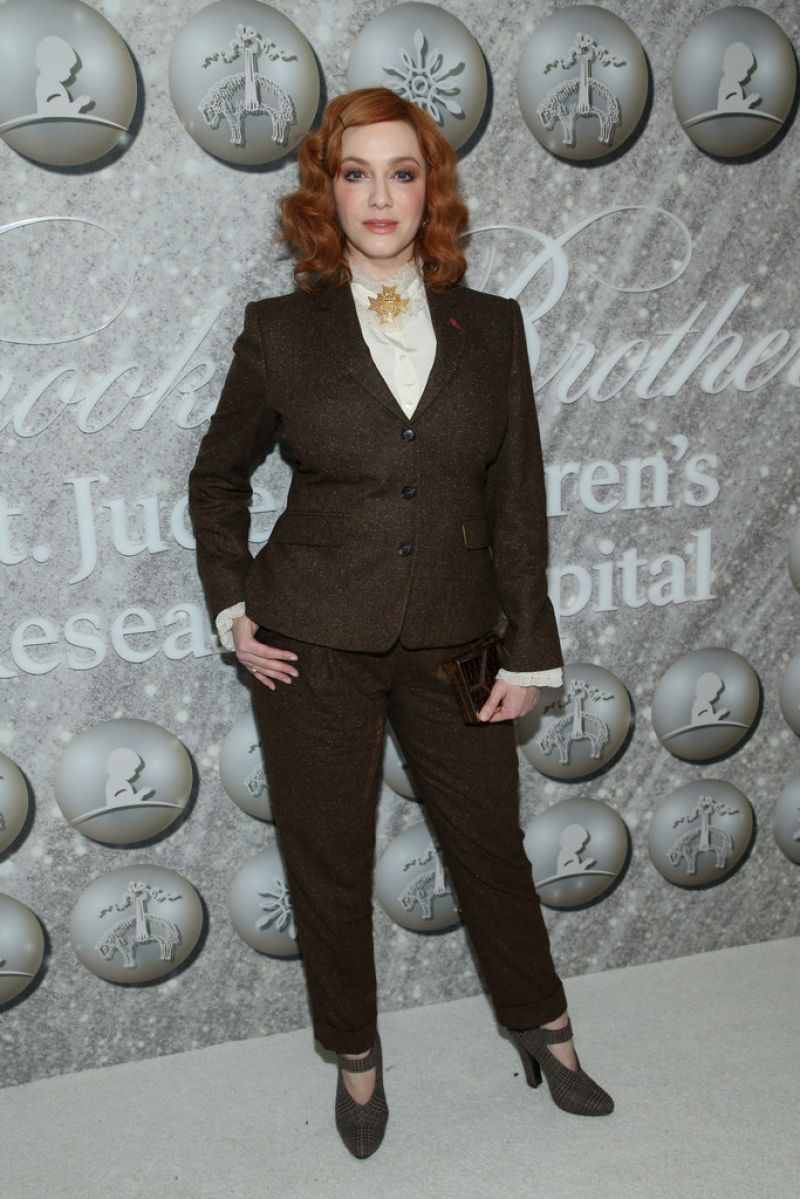 Christina Hendricks rocks a chic brown suit as she attends Brooks Brothers holiday event
