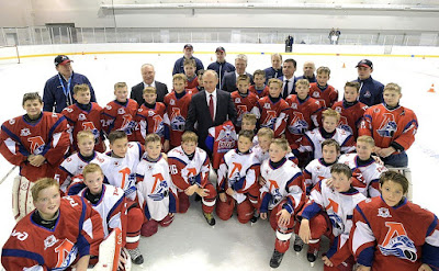 Vladimir Putin visits the new public Olympic Reserve hockey school. Russian President with members of the Lokomotiv children's hockey team.
