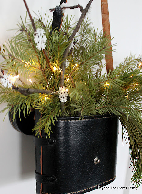 Add Twinkle lights to a winter floral arrangement