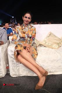 Actress Rakul Preet Singh Stills in Short Dress at Dhruva Pre Release Function  0121.JPG