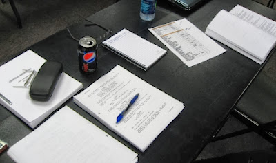 Screenplays on a table for a script reading session