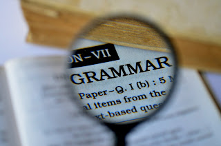 "Photo of a page from book, where ""Grammar"" is the headline."
