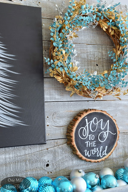 Black and White Joy to the World Wood Slice Art with Silver and Blue Christmas Ornaments and Wreath | Christmas Home Tour - One Mile Home Style
