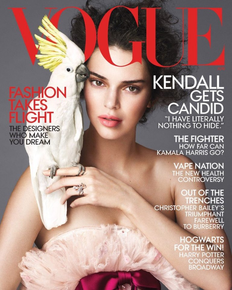 Supermodel Kendall Jenner poses alongside a cockatoo on the April 2018 cover of Vogue US