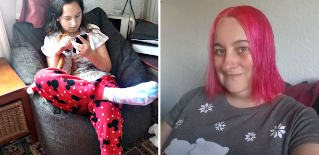 My youngest sat on our new bean bag playing on her phone and my new pink hair.