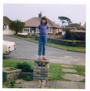 child standing on a wall 70s