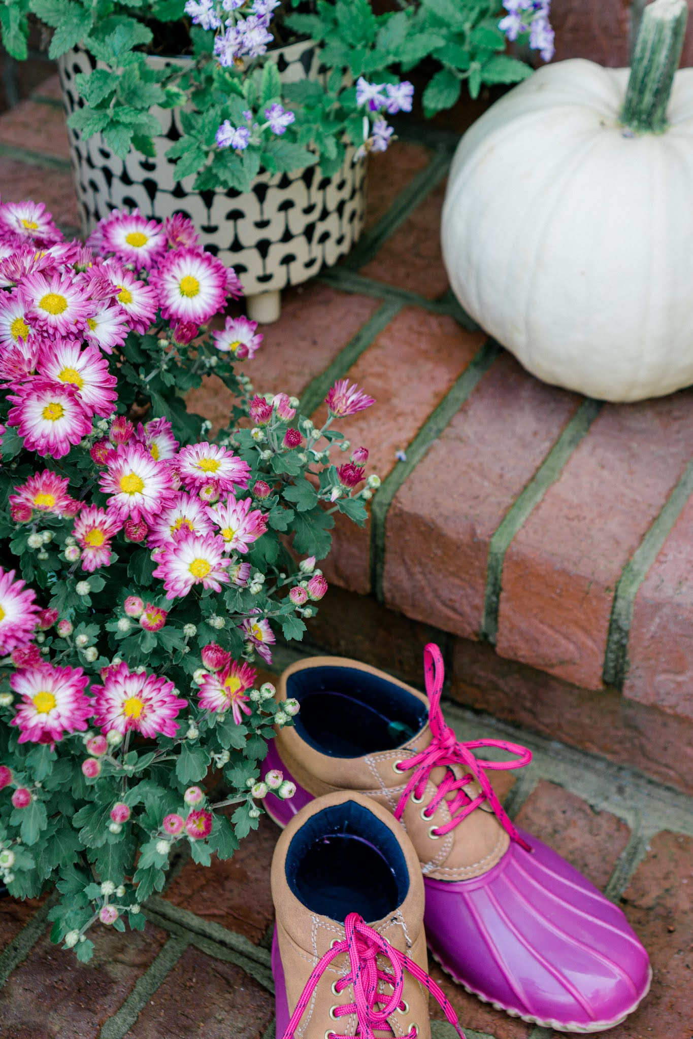 Add mums and pumpkins to your front porch for fall decorations