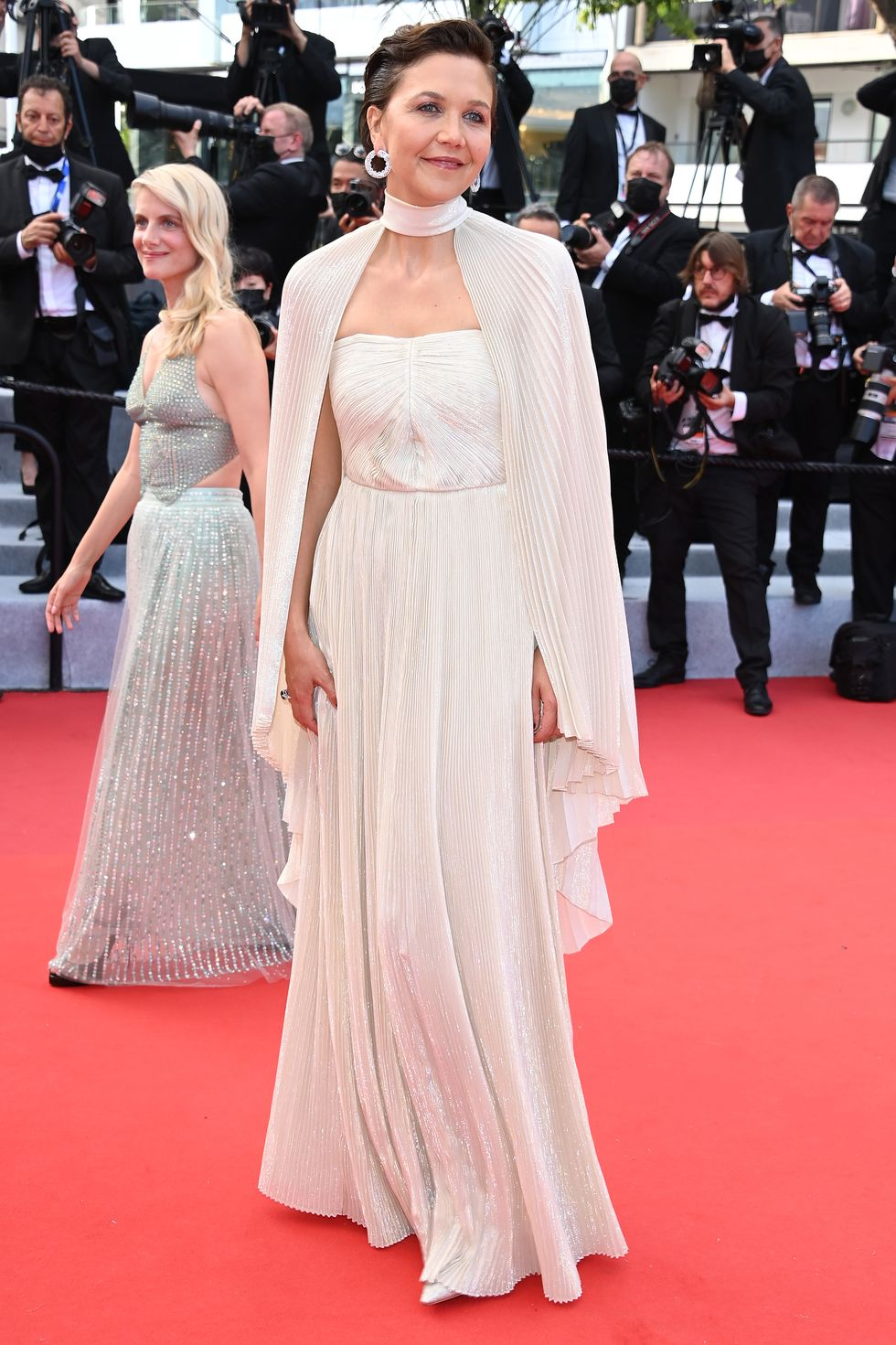 Maggie Gyllenhaal This year's jury member, Maggie Gyllenhaal, wore a chic white Celine dress with a long cape and Chopard jewels.