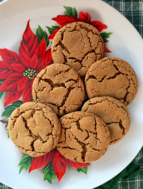 Serving plate with baked chewy molasses spice cookies.