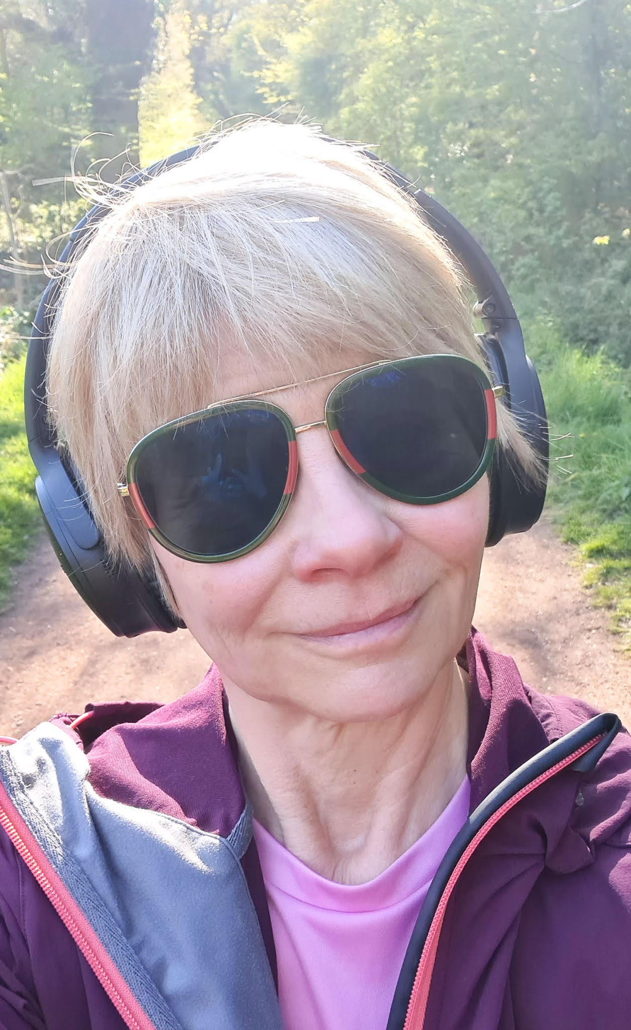 Is This Mutton writer Gail Hanlon walking in forest with headphones listening to a podcast