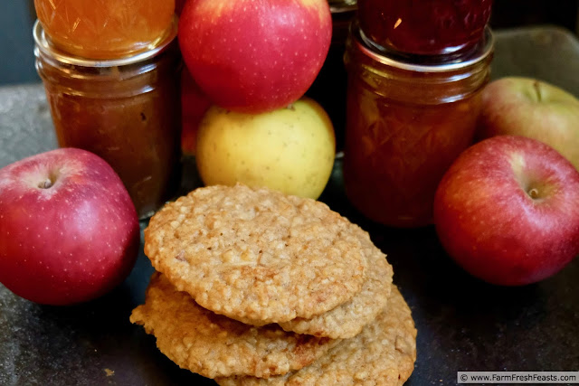 photo of apple butter muffin top cookies with apples and jars of jam