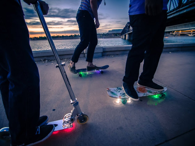 Skateboards hanging around with led on their wheels