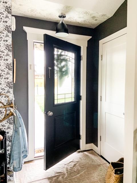 dark gray walls with black front door