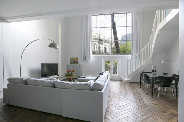 Living room of Paris apartment on private Avenue Frochot seen on Hello Lovely Studio
