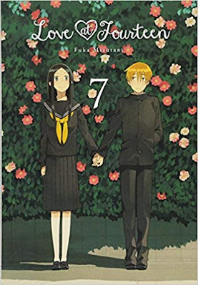 Two middle school students in school uniforms hold hands in front of a wall of flower bushes