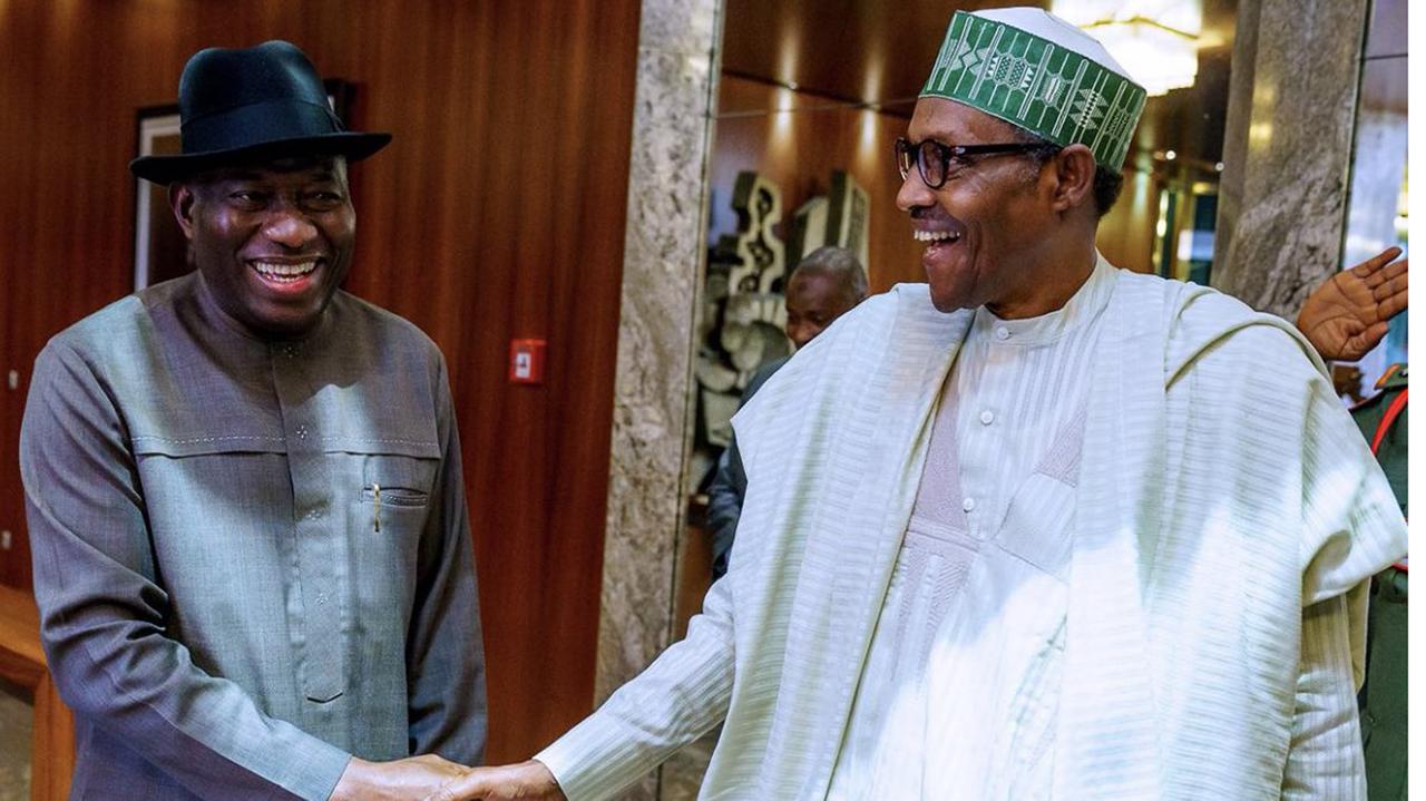 L-R: Former President Goodluck Jonathan with successor President Muhammadu Buhari (right)