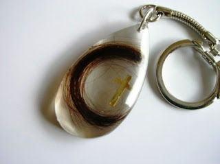 Teardrop keyring for a loved ones hair and cross