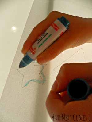 Tracing a Christmas star on the light table from And Next Comes L