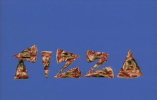 A pizza is made and the slices form the word pizza. Sesame Street Elmo's Magic Cookbook