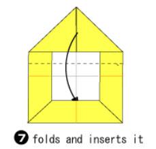 Bước 6: Gấp giấy xuống dưới theo như nét đứt và nhét vào trong
