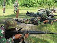 TNI Brondongkan Peluru M16 nya di Kompi Brimob Rambaitan