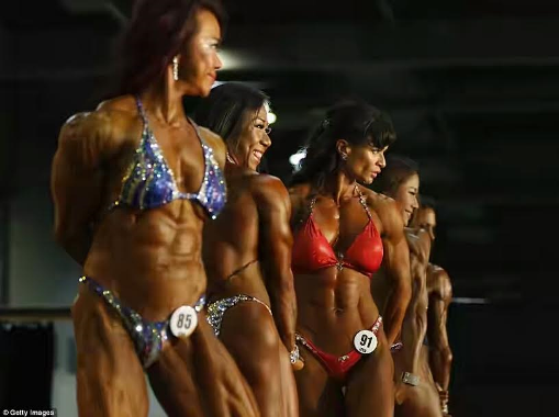 Muscular women gather in Hong Kong for the Arnold Classic muscle building competition (photos)
