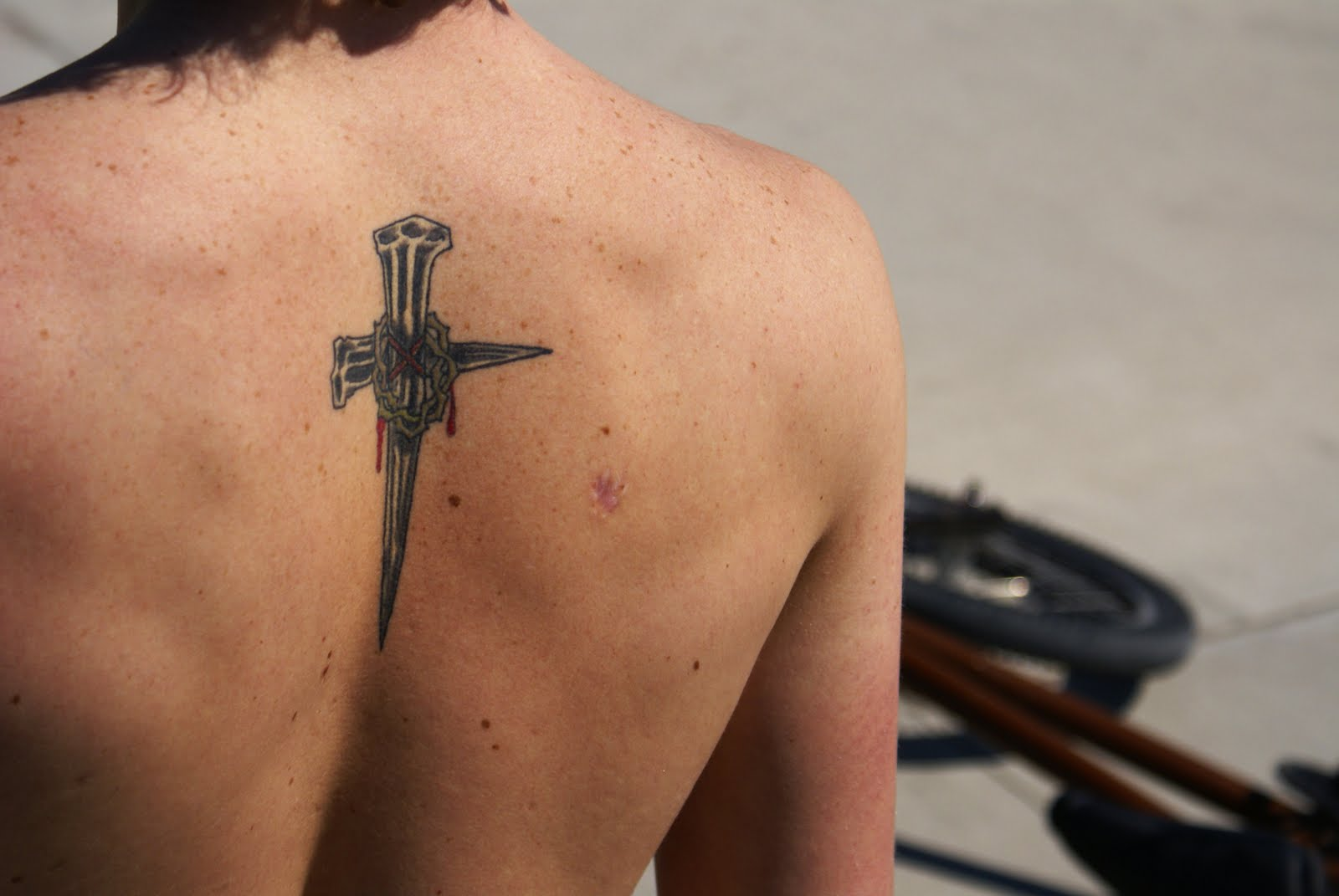 Nail Cross Tattoo: What Would Justin Beiber Do