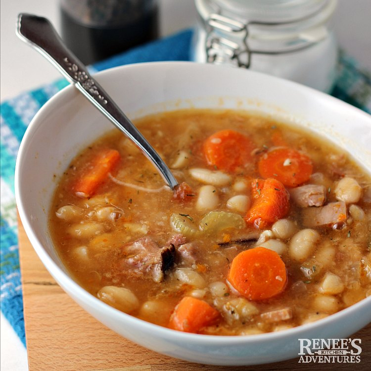 Ham and Bean soup in white bowl with spoon