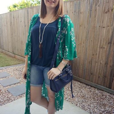 awayfromtheblue Instagram | navy tank and Bermuda denim shorts outfit with green floral duster kimono