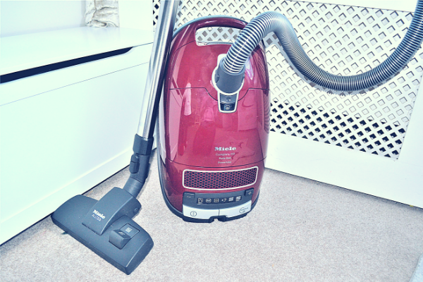 Miele Complete C3 Pure Red Bagged Cylinder Vacuum Cleaner upright with floor head and telescopic tube attached