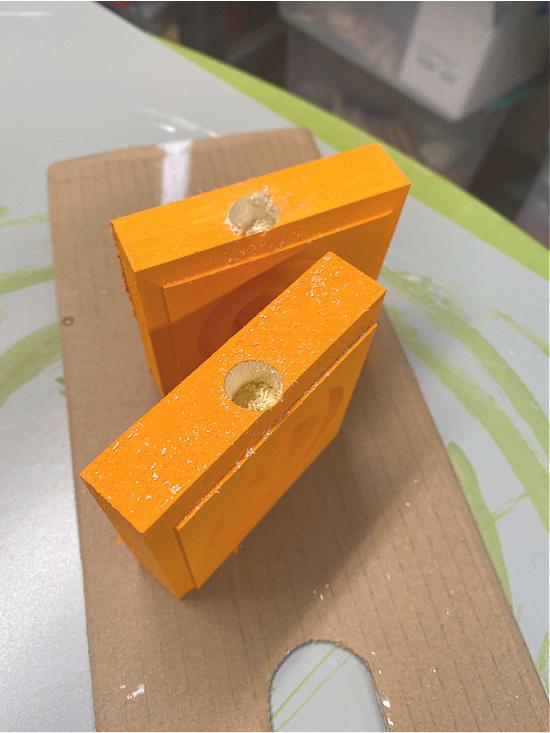 Drilled holes in orange corner moldings