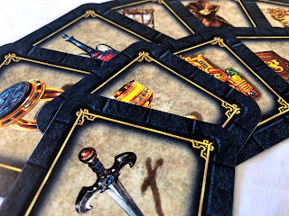 An attractive arrangement of treasure cards from Labyrinth: The Duel.