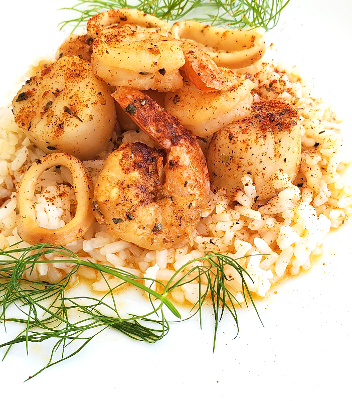 this is a beer butter sauce with seafood over rice with dill