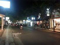 Seminyak street, Bali, sparkling in the evening