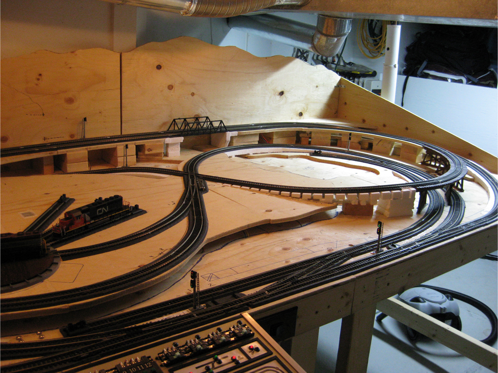 HO scale model railroad layout with installed trackside signals at various locations