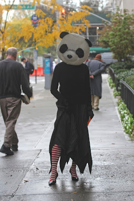 This photo features a woman wearing a panda bear full face mask  to celebrate 2019's Halloween. It is included within a post on my Facebook Page @  https://www.facebook.com/patricia.youngquist.5/posts/2536603943119374