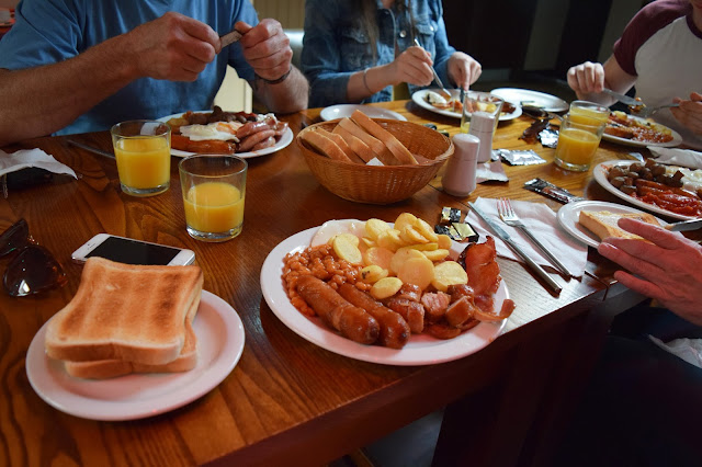 a table full of breakfast foods