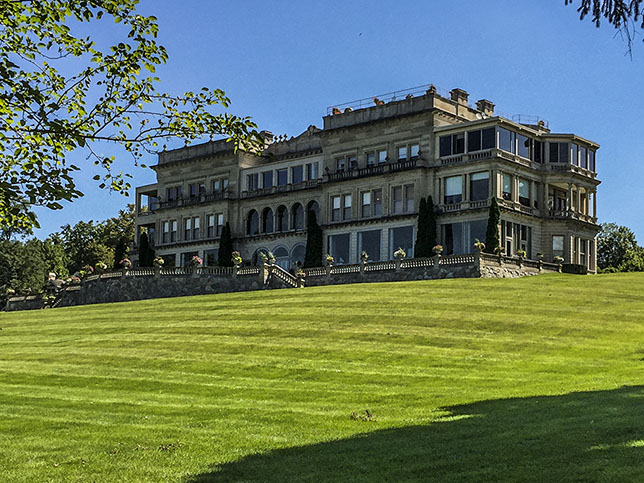 Three story stone mansion and portico