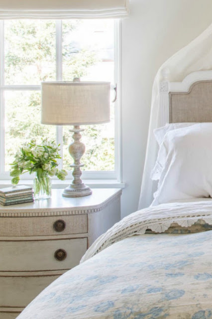 French Farmhouse style in a romantic bedroom with Swedish antiques - found on Hello Lovely Studio
