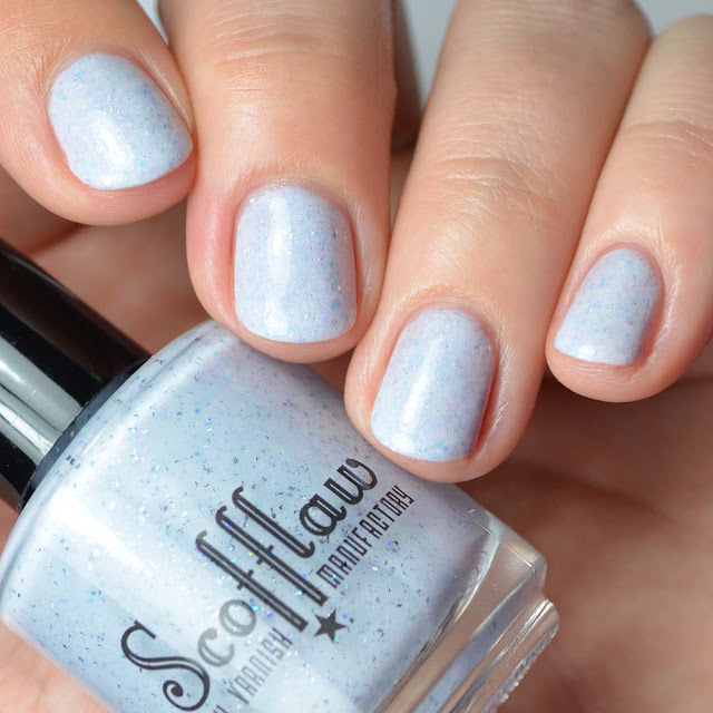 white creme nail polish with shimmer and flakies