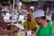 Mendung dan Rintik Hujan Tak Halangi Relawan SALAM Sosialisasi Pilkada Sehat  sembari Bagi Masker Gratis