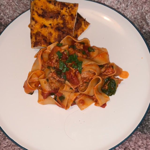 Spiced pork ragu pappardelle, with cheese and tomato flatbread