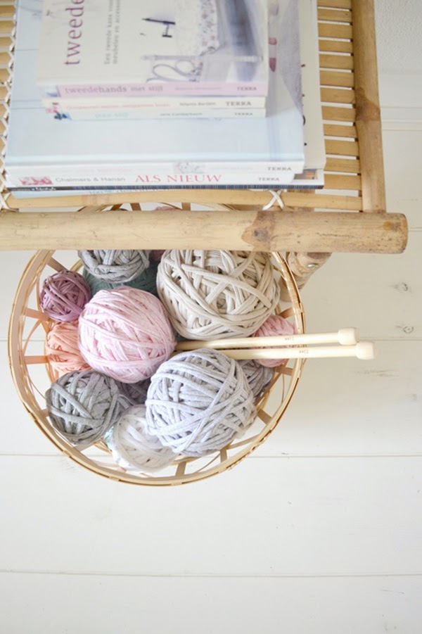 basket of tshirt yarn and knitting needles