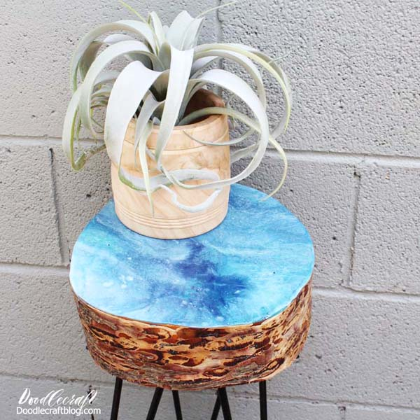 Make a log slice table using hairpin legs and a resin pour all over the top for the perfect outdoor decor.