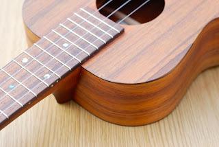 Kanile'a K1 Tenor ukulele wear on top