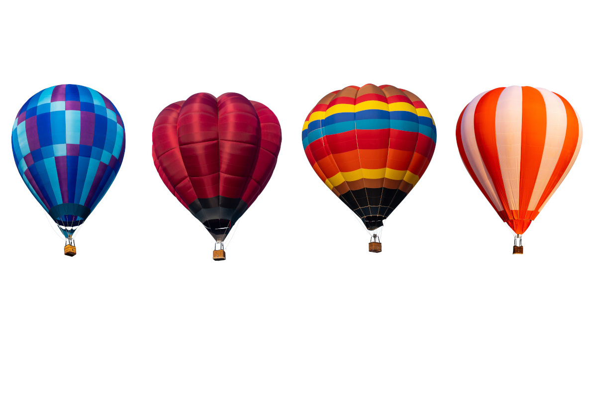 Four mulit-colored hot air ballons against a clear background