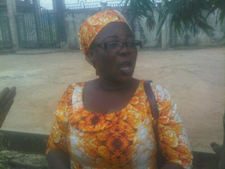 woman scooping fuel from nnpc pipeline from home