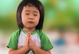 Baby praying