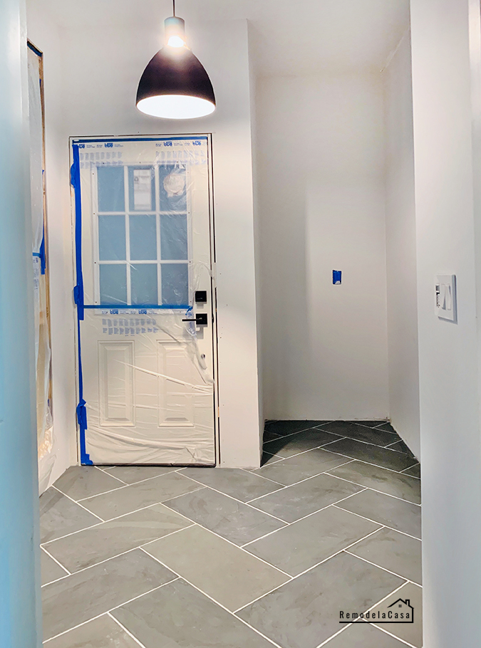 mudroom with herringbone slate tile